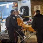 man rushed to hospital