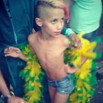 young boy at pride